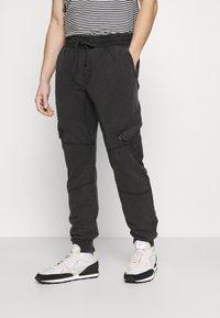 Tigha - BONO - Cargo trousers - vintage black - 0