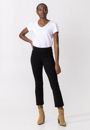 AMARA - Trousers - black