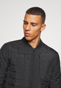 Hummel - HMLLUKE - Training jacket - black - 4