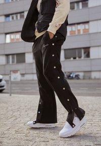 Pegador - SUEDE BUTTON PANTS UNISEX - Trousers - black - 2