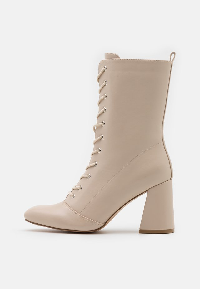 Lace-up ankle boots - bone smooth