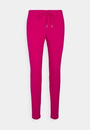 Pantalon de survêtement - fuchsia