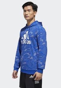 adidas Performance - ESSENTIALS ALLOVER PRINT HOODIE - Hoodie - blue - 3