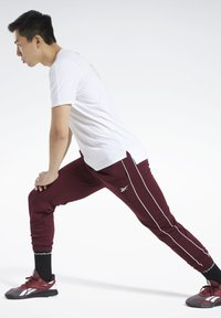 Reebok - WORKOUT READY JOGGERS - Tracksuit bottoms - burgundy - 1