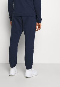 Reebok - LINEAR LOGO SET - Tracksuit - dark blue - 4
