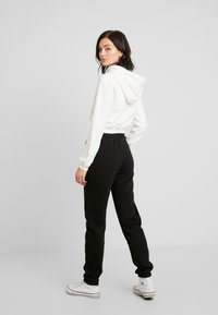 Nly by Nelly - COZY PANTS - Tracksuit bottoms - black - 2