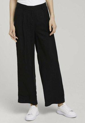 MIT WEITEM BEIN - Trousers - deep black