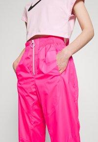 Nike Sportswear - Tracksuit bottoms - hyper pink/pinksicle/white - 4