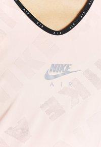 Nike Performance - AIR TANK - Sports shirt - washed coral - 6