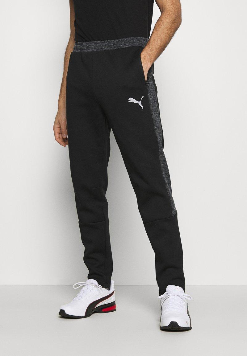 Puma - EVOSTRIPE PANTS - Pantalon de survêtement - black