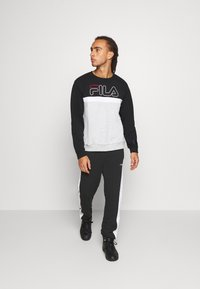 Fila - LARS  - Tracksuit bottoms - black/bright white - 1