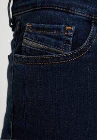 Diesel - SLANDY ZIP - Jeans Skinny Fit - indigo - 6