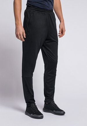 LASTON TAPERED - Tracksuit bottoms - black