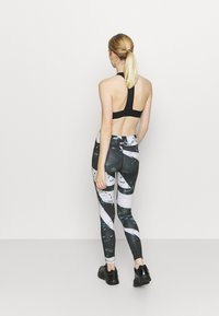 Reebok - WORKOUT READY PRINTED LEGGINGS - Punčochy - black - 2