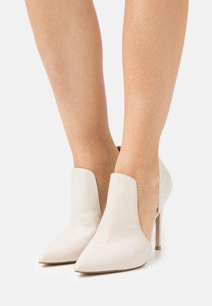 DARLIN - Classic heels - bone