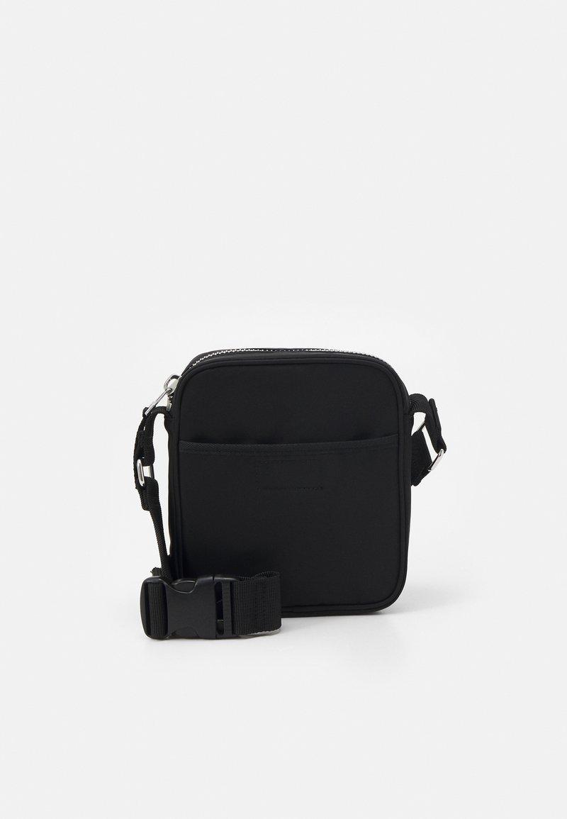 Weekday - JESSIE CROSSBODY - Across body bag - black