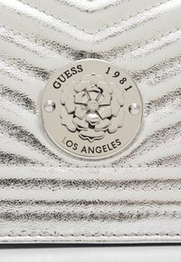 Guess - LIDA CONVERTIBLE XBODY FLAP - Handbag - silver-coloured - 3