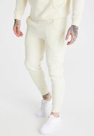 MESSI CUFFED PANT UNISEX - Teplákové kalhoty - ecru