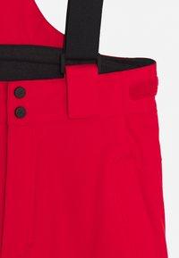 Kjus - BOYS VECTOR PANTS - Zimní kalhoty - scarlet - 3