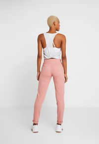 ONLY Play - ONPJAVA LOOSE PANTS - Pantalones deportivos - dusty rose - 2