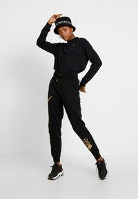 Nike Sportswear - SHINE - Tracksuit bottoms - black/metallic - 2