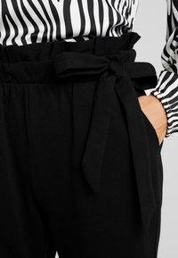 Vero Moda - VMEVA LOOSE SIDE PAPERBAG PANT - Pantalones - black - 4