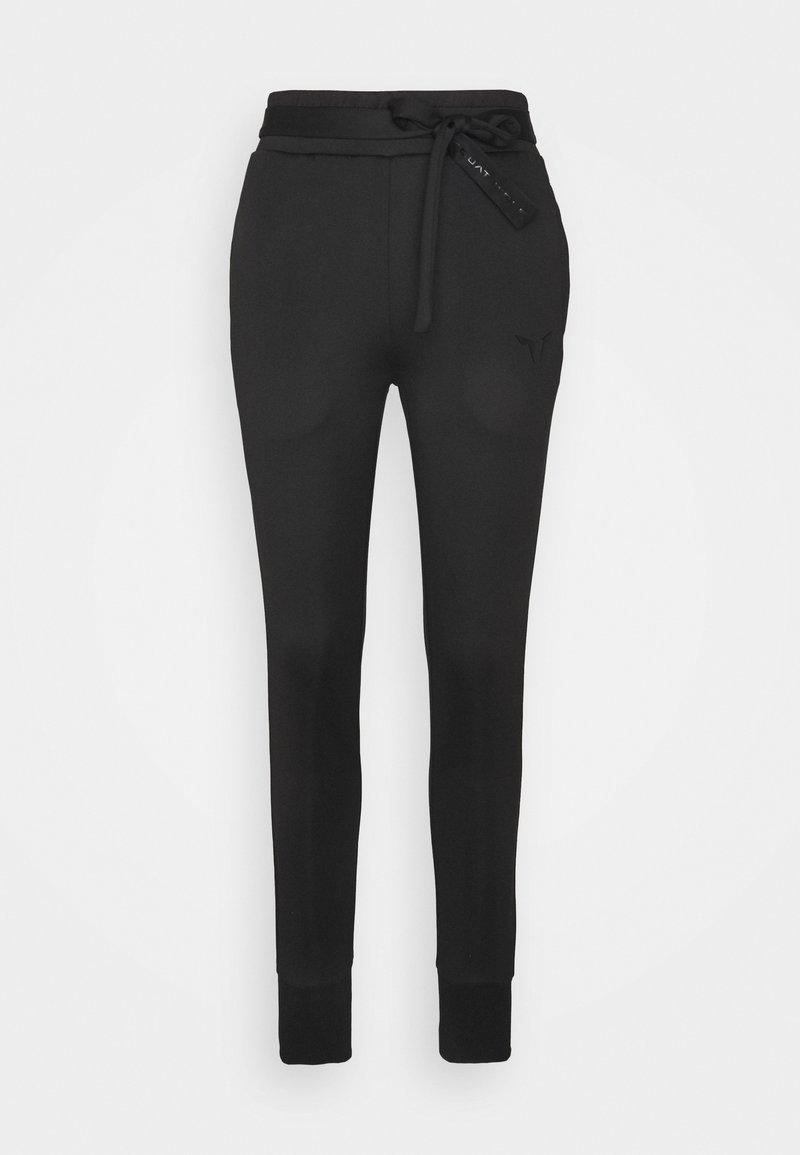 SQUATWOLF - SHE DO KNOT  - Teplákové kalhoty - black