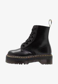 Dr. Martens Platform boot - Kotníkové boty na platformě - black