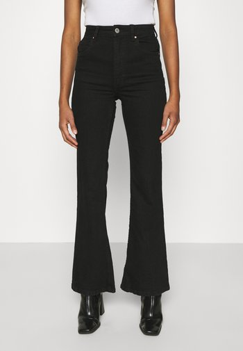 ORIGINAL - Flared jeans - black