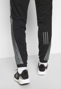 adidas Performance - BOSC - Tracksuit bottoms - black - 3