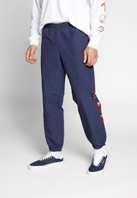 adidas Originals - FOOTBALL GRAPHIC TRACK PANTS - Tracksuit bottoms - blue - 0