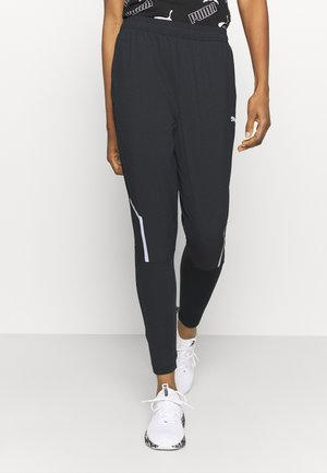 RUN TAPERED PANTS - Tracksuit bottoms - black