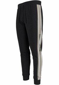 Tommy Jeans - Pantalon de survêtement - schwarz - 1