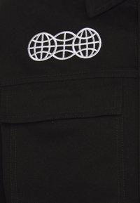 GOODBOIS - OFFICIAL WORKSHOP OVERJACKET - Lehká bunda - black - 3