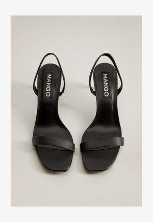 CORA - Sandaalit nilkkaremmillä - schwarz