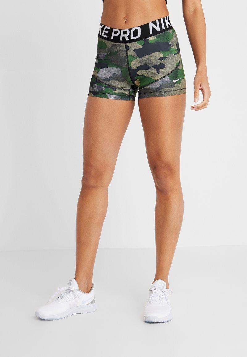 Nike Performance - REBEL CAMO - Leggings - club gold/white