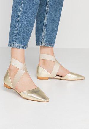 Ankle strap ballet pumps - gold