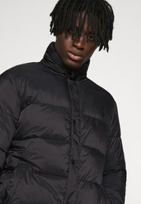 Redefined Rebel - PUFFER JACKET - Winter jacket - black solid - 3