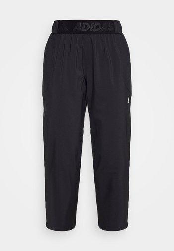 BRANDED PANT - Pantalones deportivos - black/white