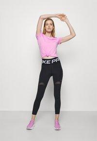 Nike Performance - ALL OVER - Basic T-shirt - beyond pink - 1