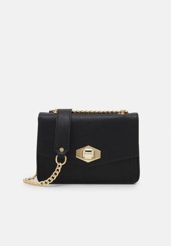 PCANNA CROSS BODY - Across body bag - black/gold-coloured
