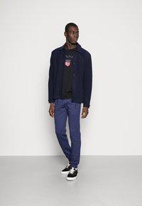 Pier One - Teplákové kalhoty - mottled dark blue - 1