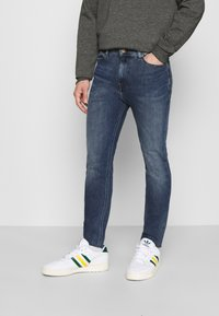 Tommy Jeans - SIMON SKINNY - Slim fit jeans - mid blue - 0
