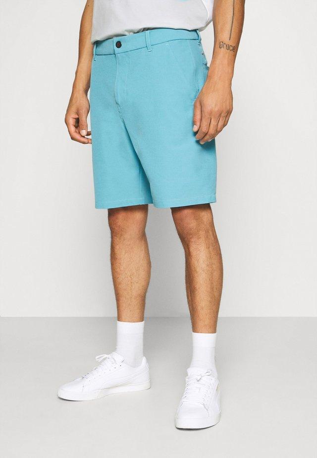 SHORT - Sports shorts - milky blue