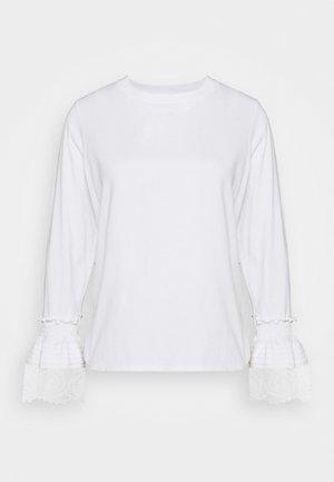 Top sdlouhým rukávem - white powder