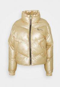 CHEST SIGNATURE PUFFER JACKET - Winter jacket - gold