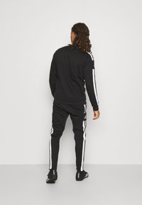 adidas Performance - SQUAD - Tracksuit bottoms - black - 2