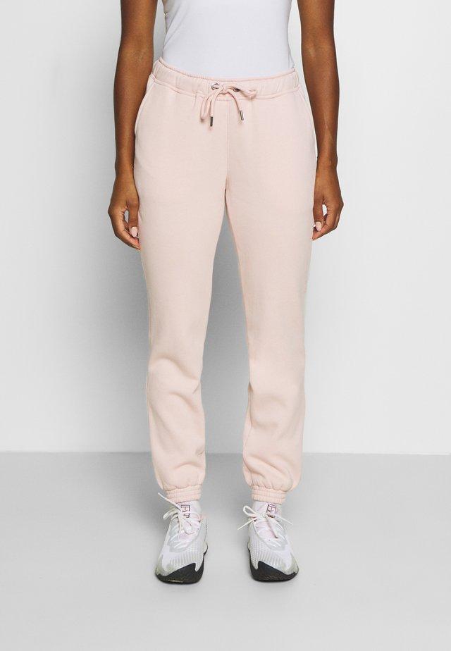 MEGHAN PANTS - Pantalones deportivos - lotus