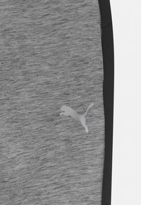 Puma - EVOSTRIPE PANTS UNISEX - Tracksuit bottoms - medium gray heather - 2