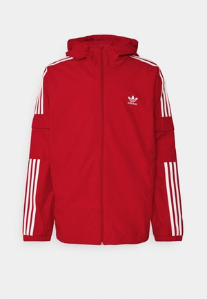 THREE STRIPES UNISEX - Chaqueta fina - scarlet